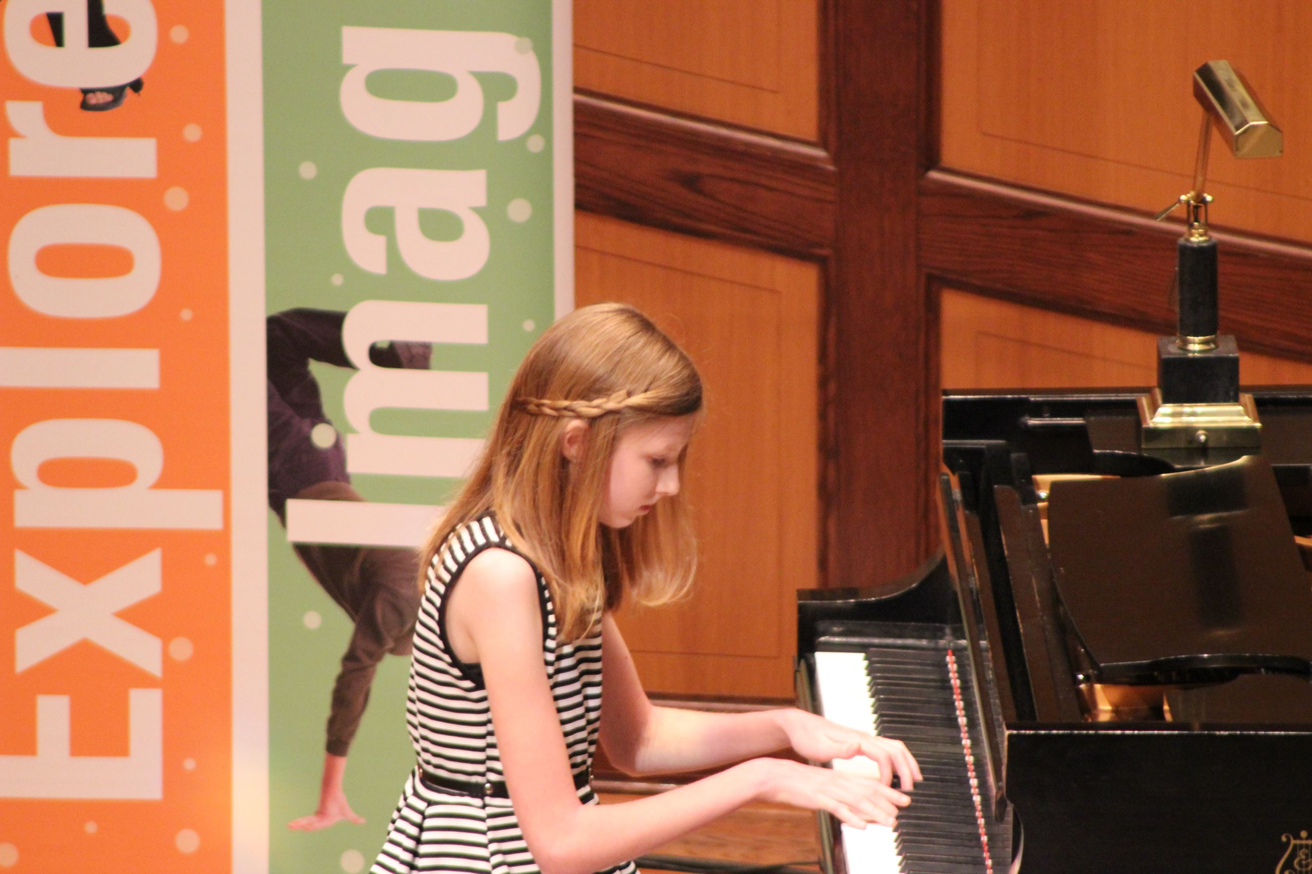 Young girl playing the piano at the Doctors in Concert event.