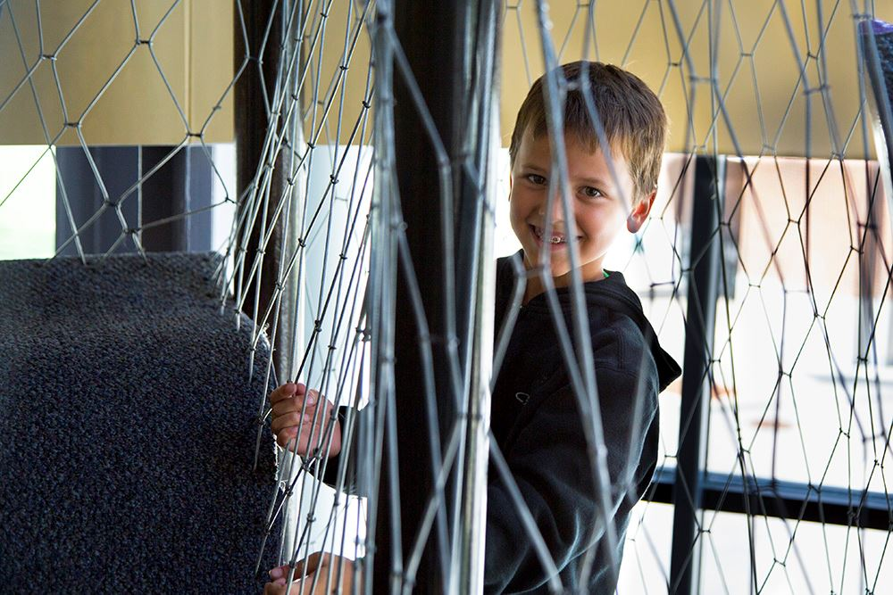 Kid smiles through net