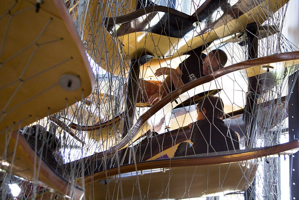 People navigate through climbing structure